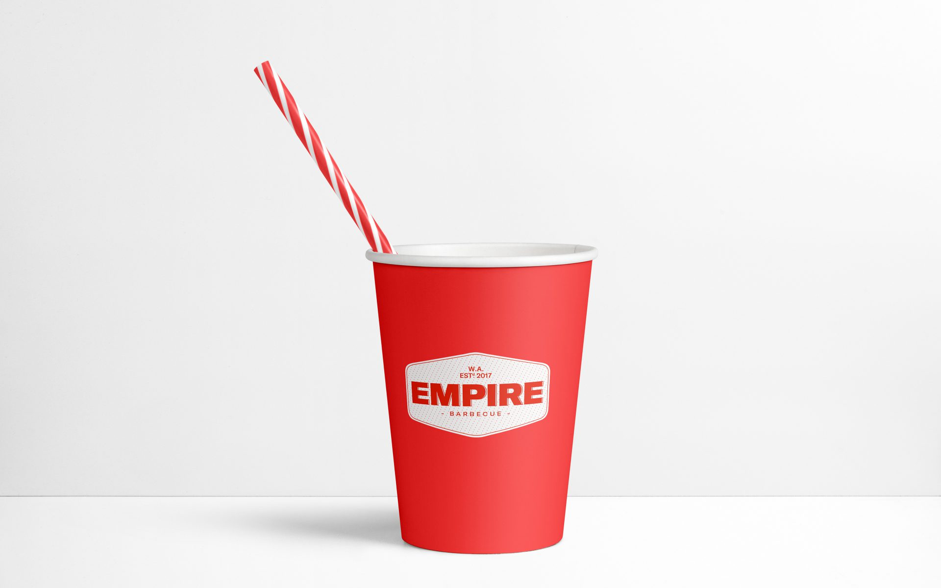 Empire BBQ brand logo on red take away cup with straw
