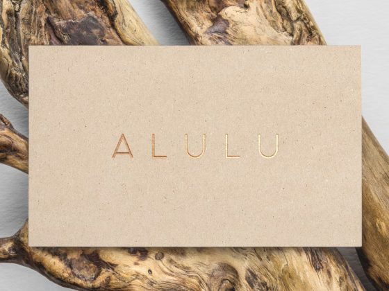 Alulu brand gold embossed on recycled business card